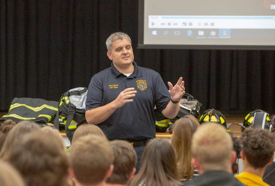 Montgomery Fire Capt. Jason Cupps talks with juniors and seniors from Elmore County High School about why the fire service is a good option for a career.