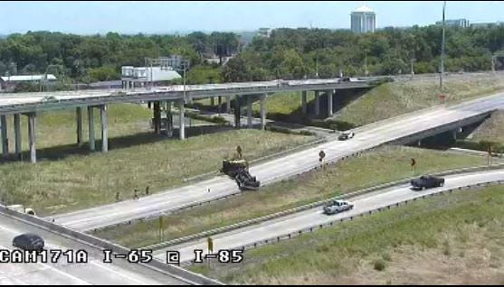 The overturned struck has blocked the on ramp of I-85 north from I-65 south.