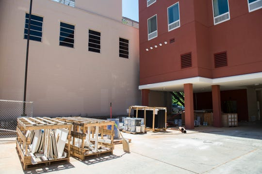 The wall where Tim Kerr's mural once was is now covered up as a new hotel is being built in Montgomery, Ala., on Wednesday, May 22, 2019.