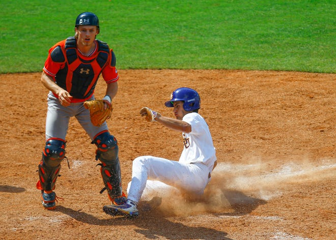 LSU's Giovanni DiGiacomo (7) slides safely into home to tie the game on a wild pitch as Auburn catcher Matt Scheffler (6) looks for the ball during the ninth inning of an SEC Tournament game on Thursday, May 23, 2019, in Hoover, Ala.