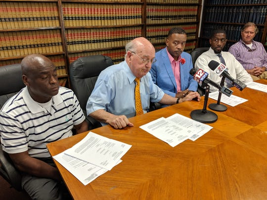 From left to right: Selma Lt. Tory Neely, attorney Julian McPhillips, Selma Sgt. Jeffrey Hardy, Selma Sgt. Kendall Thomas, and attorney David Sawyer sit at a press conference announcing the dismissal of charges against the officers on May 23, 2019.