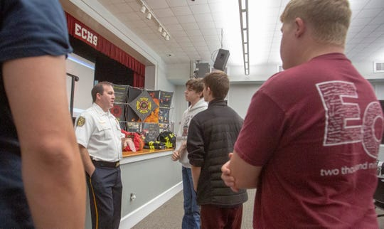 Elmore County High School students talk with Montgomery Fire Assistant Chief Allen Wiggins about the fire service during a recruiting trip to the school.