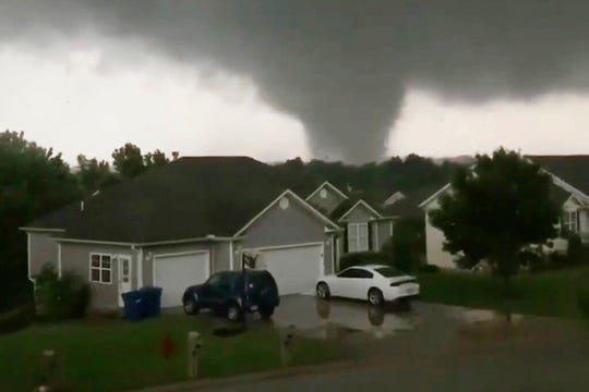 This still image taken from video provided by Chris Higgins shows a tornado in Carl Junction, Mo., on Wednesday, May 22, 2019. The tornado caused damage in the town about 4 miles north of the Joplin airport.