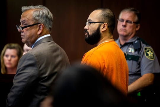 Hector Manley, center, a former Parkside Elementary School teacher who has been accused of 19 counts of lewd and lascivious molestation and two counts of capital sexual battery against someone younger than 12, appears in court with his attorney Jerry Berry, left, on Thursday, May 23, 2019. He pleaded not guilty to the latest charges.
