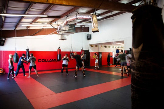 Cosmo Alexandre teaches a class at Evolution MMA in North Naples on Wednesday, May 22, 2019.
