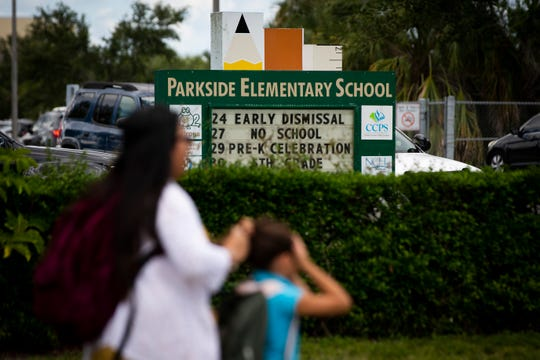A parent and child walk home after school at Parkside Elementary School in Naples on Tuesday, May 21, 2019. Hector Manley, a former Parkside Elementary School teacher, has been accused of 20 counts of lewd and lascivious molestation and two counts of capital sexual battery against someone younger than 12. Children told investigators that Manley touched them inappropriately at school and at soccer practice, where he was a coach for a local team.