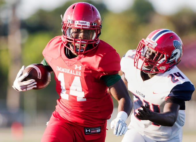Immokalee High School's Charles Toombs scores a touchdown against Clearwater Superior-Collegiate in a spring game at Immokalee on Wednesday. Immokalee beat Clearwater Superior-Collegiate 21-14.