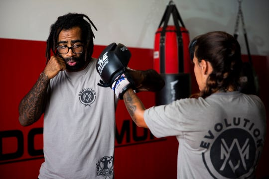 Cosmo Alexandre, left, coaches Larissa Freitas during a class at Evolution MMA in North Naples on Wednesday, May 22, 2019.