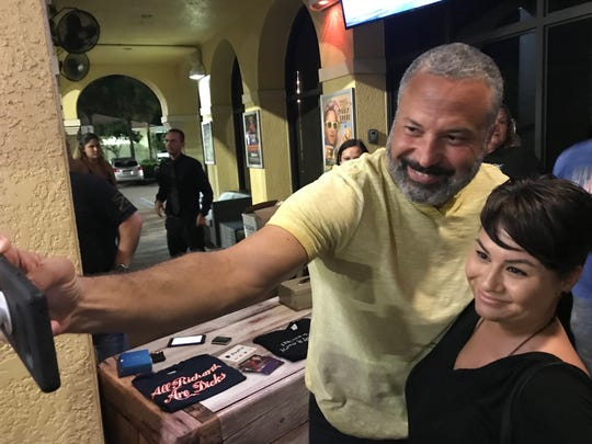 Comedian Ahmed Ahmed takes a selfie with Samantha Fike of Fort Myers on May 22, 2019, at Off The Hook Comedy Club in Naples, Florida.
