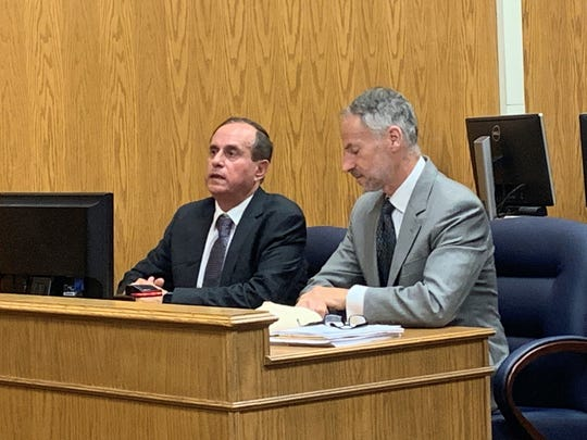 Yoav Kapah (left) responds to questions from Judge David Branstool during a sentencing hearing on Thursday, May 23, 2019. Kapah pleaded guilty to eight felonies, including theft, tampering with records, and fraudulent returns.