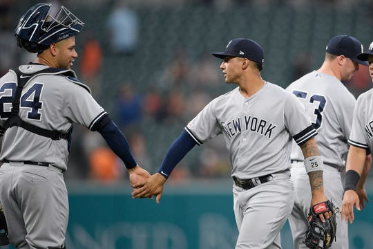 New York Yankees' Gleyber Torres, right, and Gary Sanchez celebrate after a baseball game against the Baltimore Orioles, Thursday, May 23, 2019, in Baltimore. The Yankees won 6-5.