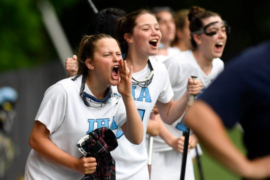 The IHA bench cheers for their team on the sideline. IHA defeated Ramapo 11-9 for the North 1, Group 3 girls lacrosse sectional championship on Thursday, May 23, 2019, in Washington Township.
