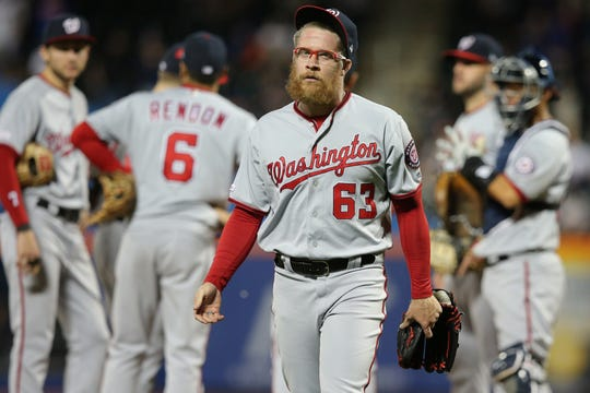 May 22, 2019; New York City, NY, USA; Washington Nationals relief pitcher Sean Doolittle (63) reacts after being relieved during the eighth inning against the New York Mets at Citi Field. Mandatory Credit: Brad Penner-USA TODAY Sports