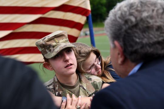 Sophie-Leigh Baxter Clark, home from active duty, surprises her sister Amber Clark, a student at Ramsey High School, during the Memorial Day Ceremony on Thursday May 23, 2019.