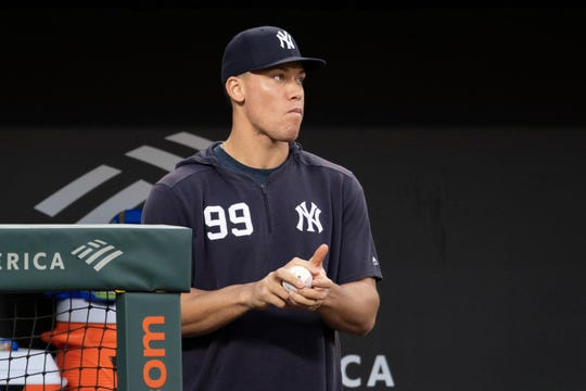 May 22, 2019; Baltimore, MD, USA;  New York Yankees outfielder Aaron Judge (99) stands in the dugout during the second inning against the Baltimore Orioles at Oriole Park at Camden Yards.