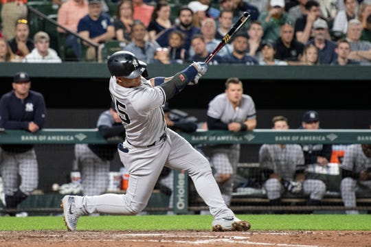 May 22, 2019; Baltimore, MD, USA;  New York Yankees shortstop Gleyber Torres (25) hits a solo home run in the fifth inning against the Baltimore Orioles at Oriole Park at Camden Yards. Mandatory Credit: Tommy Gilligan-USA TODAY Sports