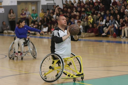 Jimmy Jeffreys teaches students the basics of wheelchair basketball at Dr. Hani Awadallah School, in Paterson. Thursday, May 23, 2019