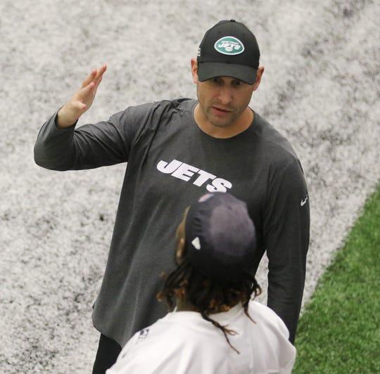 Head coach Adam Gase talks with linebacker CJ Mosely.