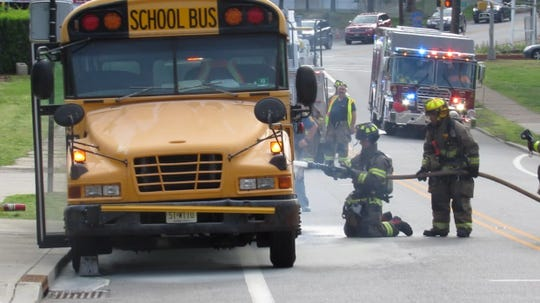 The brakes on a school bus caught fire in Hawthorne May 22, 2019 with several children on board but no one was hurt.