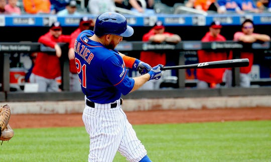 New York Mets third baseman Todd Frazier (21) singles against the Washington Nationals during the first inning at Citi Field.
