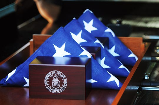 Each veteran is honored with a folded flag and a mahogany box that contains their remains and bears the insignia of their branch of service.