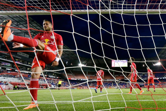 New York Red Bulls defender Amro Tarek kicks the ball into the net in response to a goal by Vancouver Whitecaps midfielder Scott Sutter during the first half of an MLS soccer match Wednesday, May 22, 2019, in Harrison, N.J. (AP Photo/Julio Cortez)