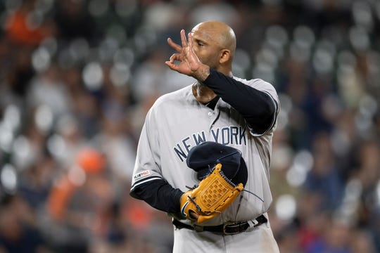 May 22, 2019; Baltimore, MD, USA;  New York Yankees starting pitcher CC Sabathia (52) signals to catcher Gary Sanchez (not pictured) during the fourth inning against the Baltimore Orioles at Oriole Park at Camden Yards. Mandatory Credit: Tommy Gilligan-USA TODAY Sports