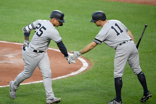 New York Yankees' Gleyber Torres (25) celebrates his home run with Brett Gardner (11) during the third inning of the team's baseball game against the Baltimore Orioles, Wednesday, May 22, 2019, in Baltimore. (AP Photo/Nick Wass)