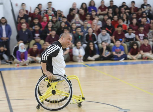 Jimmy Jeffreys shows students the basics of wheelchair basketball at Dr. Hani Awadallah School, in Paterson. Thursday, May 23, 2019