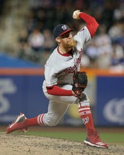 May 22, 2019; New York City, NY, USA; Washington Nationals relief pitcher Sean Doolittle (63) pitches against the New York Mets during the eighth inning at Citi Field.