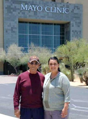 Debbie Garcia Hamilton escorted her father, Augustine Garcia, from the Mayo Clinic in Phoenix following a transplant operation that put one of Debbie's healthy kidneys into her father, giving him a new lease on life.