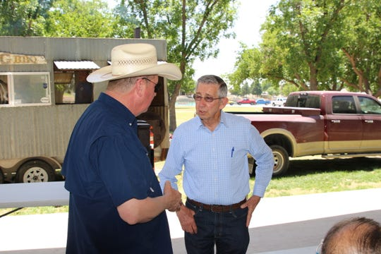 City of Carlsbad Public Works Director Pat Cass (left) speaks with Carlsbad Mayor Dale Janway during a May 23 cookout for public works employees.