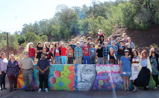 High Rolls/Mountain Park Elementary students, faculty and others in front of the school's new mural.