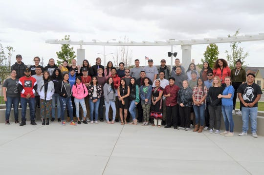Rocinante High School graduates pose for a group photo outside the Farmington Civic Center. Their commencement ceremony was on May 22.