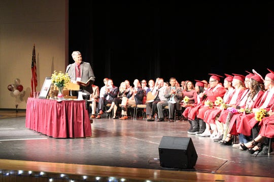 Farmington Municipal School District Superintendent Gene Schmidt welcomes the crowd to the Rocinante High School commencement ceremony on May 22 at the Farmington Civic Center.