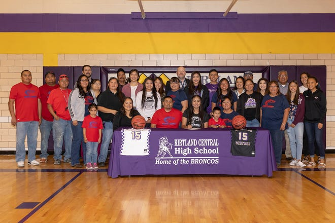 Kirtland Central's Aubrey Thomas, center, signs her national letter of intent on Thursday to play basketball at the University of the Southwest in Hobbs.