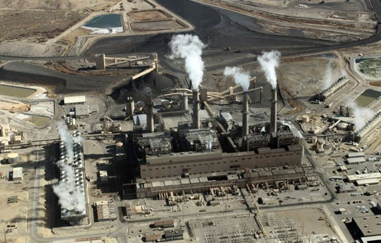 FILE - This Nov. 9, 2009, file photo shows the coal-fired San Juan Generating Station near Farmington.