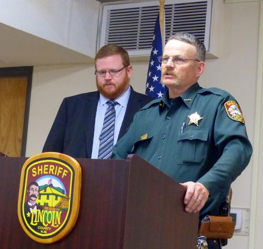 Lincoln County Sheriff Robert Shepperd, at podium, and 12th Judicial District Attorney John P. Sugg talked to reporters after Magill's arrest in 2017.