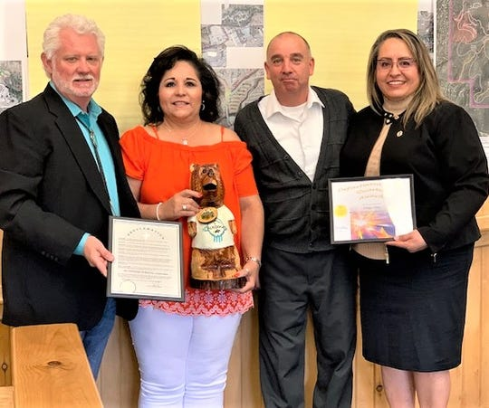 Mayor Lynn Crawford, left, presented the Department of the Quarter Award to Deputy Clerk Bertha de los Santos, second left, and Village Clerk Irma Devine, right. Also congratulating the two was Deputy Village Manager Ron Sena.