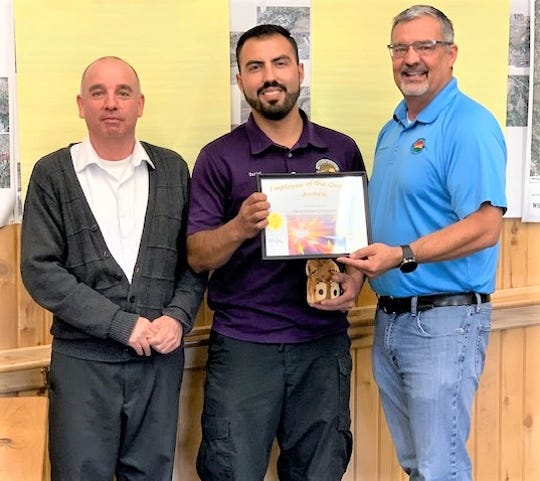 Daniel Bastardo-Dominquez, center, received his award from Sierra Blanca Regional Airport Dircetor Sean Parker, right, and Deputy Village Manager Ron Sena.