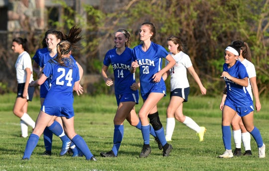 Smiling and happy Salem High Rocks run back from yet another first half goal against Franklin High.