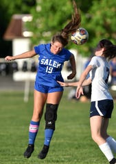 Salem High Rock Madison Servey, left, out-competes Franklin's Emily Esker for a ball in mid-air.