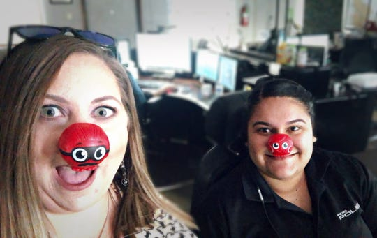 Indio Police Department staffers show off their red noses on Red Nose Day, a project to raise money for children in need across the country.