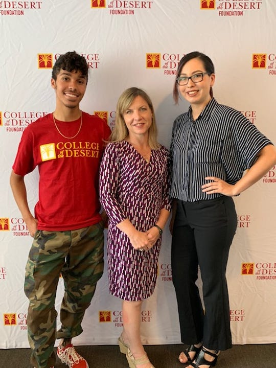 Recent College of the Desert graduates Shane Tate, left, and Alexandria Rosales, right, with Desert Sun Executive Editor Julie Makinen. Tate and Rosales will work as interns this summer at The Desert Sun.