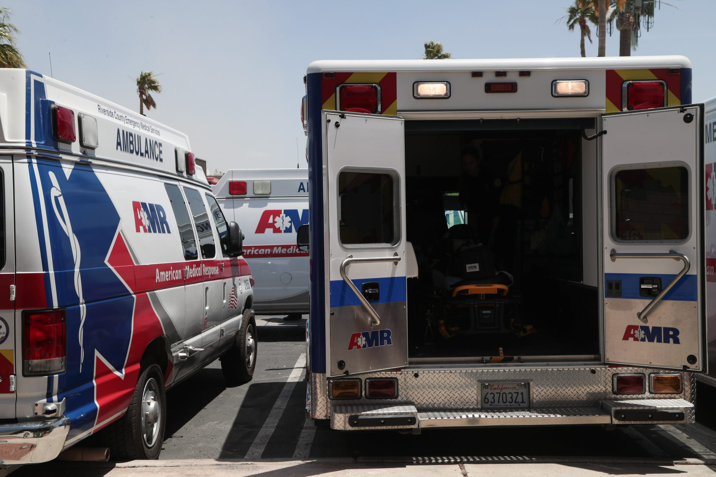 Ambulances are loaded up for shifts at American Medical Response in Palm Springs, Calif., May 22, 2019.