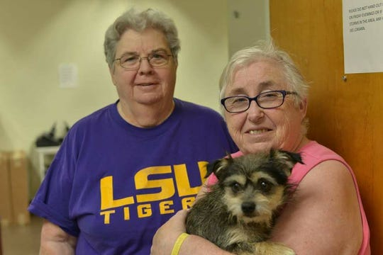 Helen King (left) and Elaine King pose with Scruffy, their first foster dog with Friends of the Escambia County Animal Shelter.