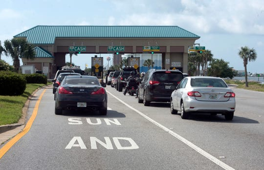 On Thursday, May 23, 2019, Motorists driving to Pensacola Beach and using cash to pay the bridge toll can now use the two left lanes. The Sun Pass only lanes are relocated to the far right at the Bob Sikes toll plaza.