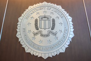 Two FBI agents were injured on Friday morning while serving a warrant in Mesa.