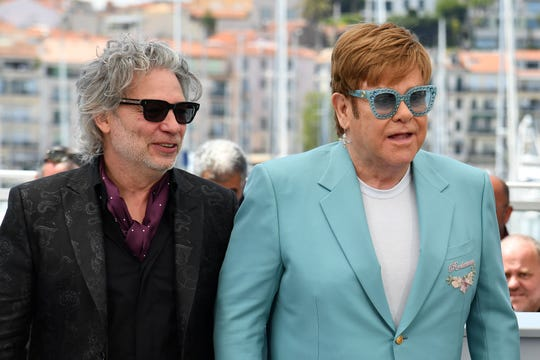 "Director Dexter Fletcher (left) enjoyed working with Elton John on the biopic ""Rocketman."""