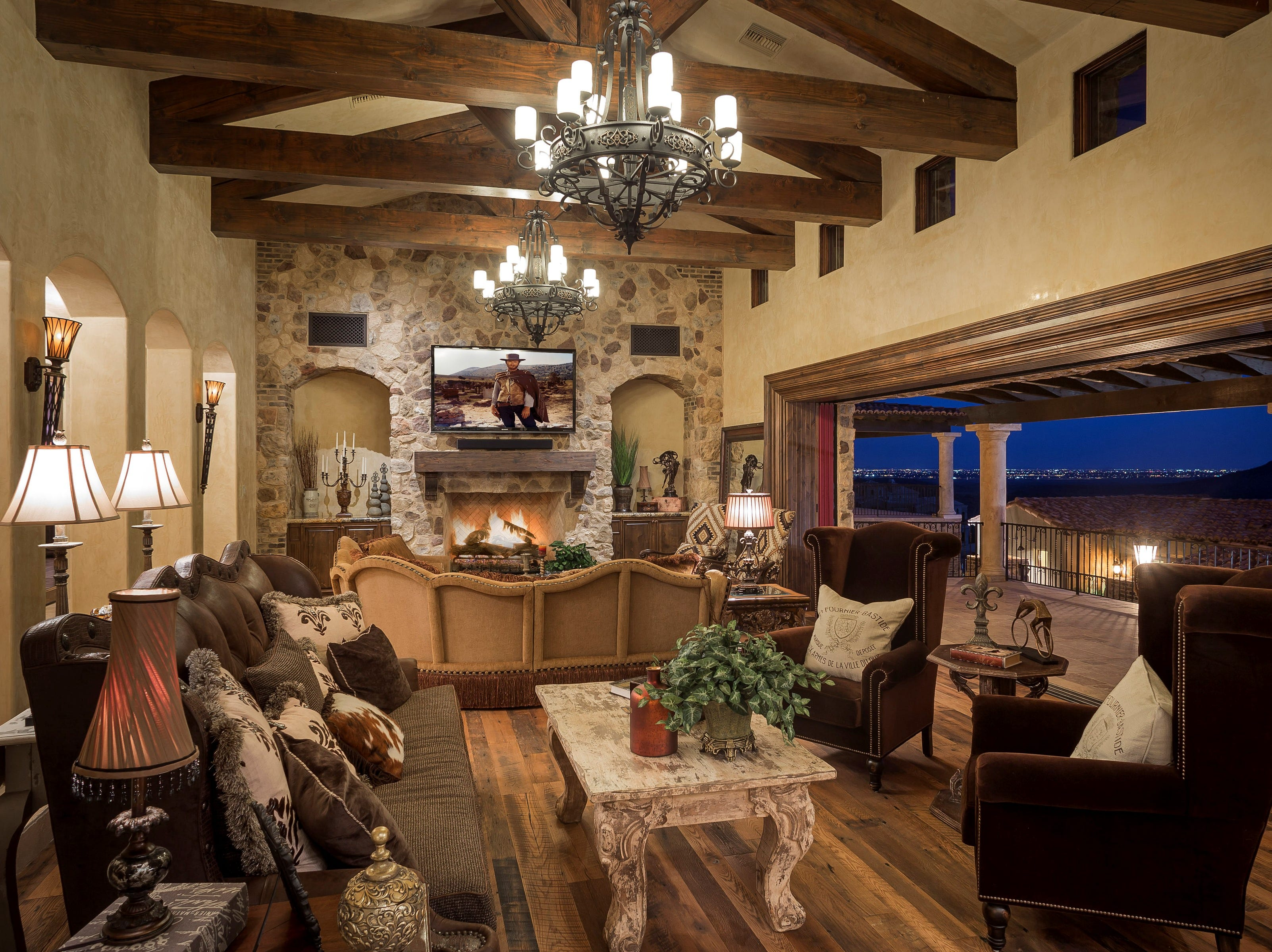 The $3.4M Fountain Hills mansion, sold by Craig and Debra Shaw, features exposed wooden beams and sliding glass walls.